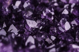 A pile of amethyst gemstones, representing one of Assunta Iannilli's accounting service packages for small BC businesses