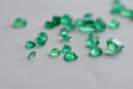 A pile of emerald gemstones, representing one of Assunta Iannilli's accounting service packages for small BC businesses