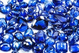 A pile of sapphire gemstones, representing one of Assunta Iannilli's accounting service packages for small BC businesses